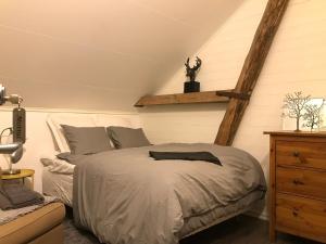Säng eller sängar i ett rum på Laxgårdens Bed and Breakfast