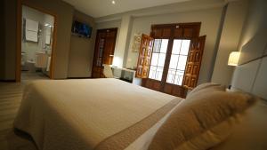 Cama o camas de una habitación en Hotel Infante Antequera