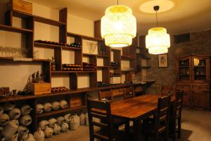 A restaurant or other place to eat at ARTS IN Country House Linha do Dão
