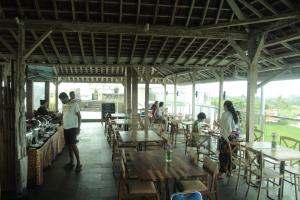 A restaurant or other place to eat at The Evitel Resort Ubud