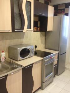 Кухня или мини-кухня в апартамент у Роял Марин
