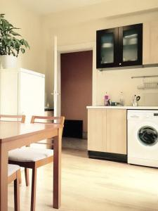 A kitchen or kitchenette at Interhost Guest rooms and apartments