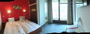 Кровать или кровати в номере Hôtel de Ville