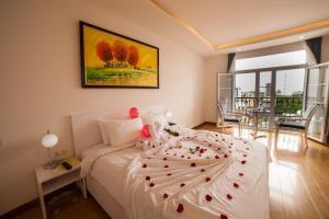 Un ou plusieurs lits dans un hébergement de l'établissement Hotel La Perle