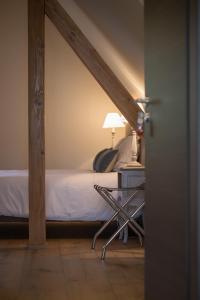 Un ou plusieurs lits dans un hébergement de l'établissement Les Chambres Chez Christine