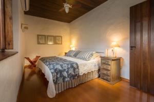 Cama ou camas em um quarto em Fazenda Capoava