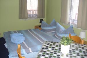 Ein Bett oder Betten in einem Zimmer der Unterkunft Penzion Seidl