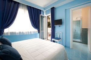 Letto o letti in una camera di Hotel Bougainville
