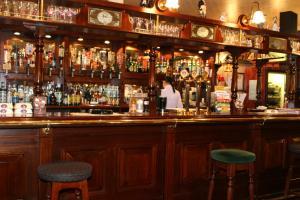 The lounge or bar area at Korona Hotel