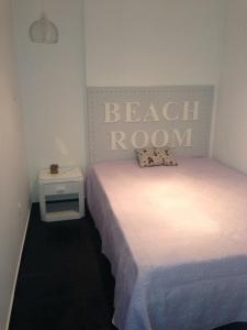 A bed or beds in a room at Beach House Rocha CPR3