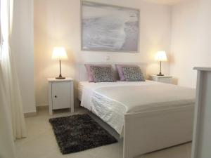 A bed or beds in a room at Apartments Anica