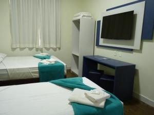 A bed or beds in a room at Centralle Sorocaba Hotel
