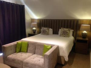 A bed or beds in a room at Wild Mushroom Country House