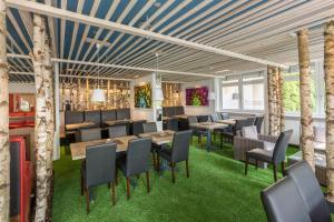 Een restaurant of ander eetgelegenheid bij Hotel SoleGARTEN