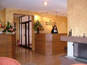 The lobby or reception area at Family Hotel Emaly 1
