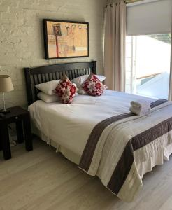 A bed or beds in a room at Life on 3rd