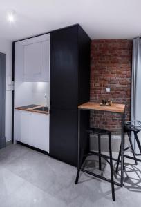 Kuchnia lub aneks kuchenny w obiekcie Business&Relax Apartment