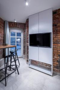Telewizja i/lub zestaw kina domowego w obiekcie Business&Relax Apartment