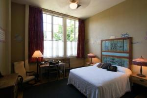A bed or beds in a room at McMenamins Kennedy School