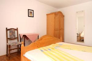 A bed or beds in a room at Apartment Plat 4792a