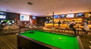 A pool table at Nightcap at Kawana Waters Hotel