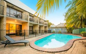 The swimming pool at or near Nightcap at Kawana Waters Hotel