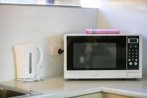 A kitchen or kitchenette at Nightcap at Kawana Waters Hotel