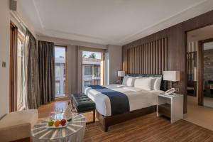 A bed or beds in a room at Henann Crystal Sands Resort