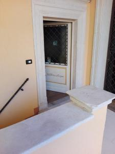 A bed or beds in a room at B&B Palazzo Cappa
