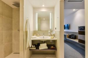 A bathroom at i - PARK Hotel Klingholz