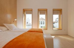 Cama o camas de una habitación en Boutique Hotel Holos