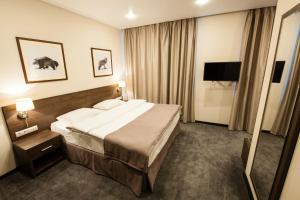 Кровать или кровати в номере Санаторно-оздоровительный комплекс ТИРВАС