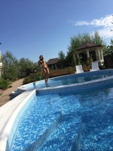 The swimming pool at or near Usadba Mirada