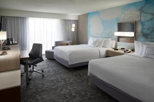 A bed or beds in a room at Courtyard by Marriott Toronto Airport