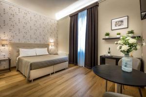 Letto o letti in una camera di Martelli 6 Suite & Apartments