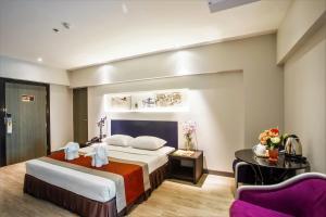 Letto o letti in una camera di Nouvo City Hotel