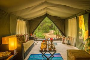 A seating area at Mahoora - Yala by Eco Team - Level 1 Certified