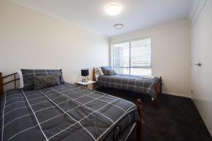 A bed or beds in a room at Executive Home Accomodation