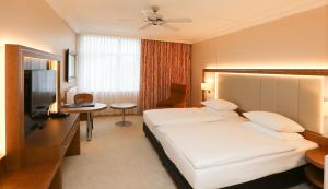 A bed or beds in a room at Hotel La Strada