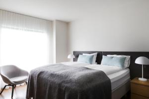 A bed or beds in a room at Hotel Berg by Keflavik Airport