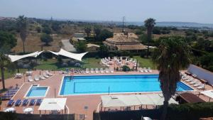 A view of the pool at Hotel Relax or nearby