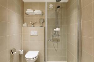 Ett badrum på Elite Hotel Carolina Tower