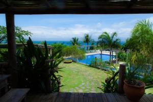 A view of the pool at Pousada Armação dos Ventos or nearby