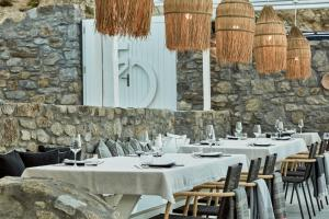 A restaurant or other place to eat at Mykonos No5 Luxury Suites & Villas
