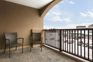 A balcony or terrace at Days Inn & Suites by Wyndham Brandon