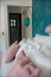 A bed or beds in a room at Villa Balthazar
