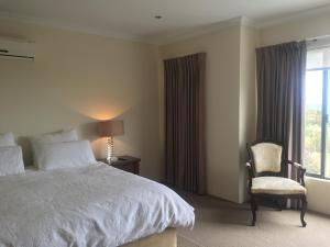 A bed or beds in a room at Busselton on the Beach