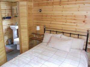 A bed or beds in a room at Waney Lodge