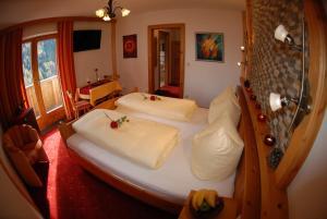 Ein Bett oder Betten in einem Zimmer der Unterkunft Gafluna