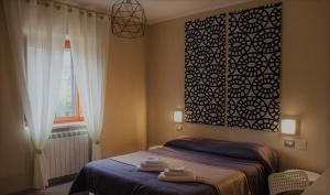 A bed or beds in a room at Villa Oreste